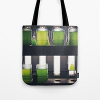 attack on titan Tote Bags featuring Titan by xoxo