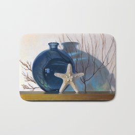 Still life with a blue vase and a starfish Bath Mat