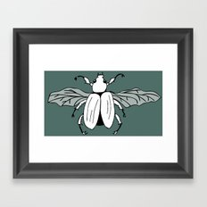 It's a beetle and it has wings. Framed Art Print