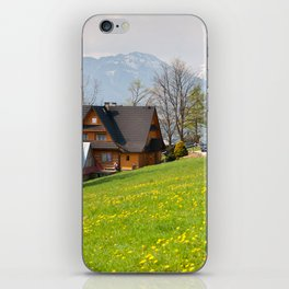 Bucolic spring meadow and house iPhone Skin