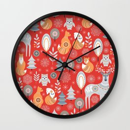 Scandinavian Christmas pattern on a red background. Deer, owls, foxes, trees and grass, snowflakes. Wall Clock