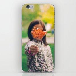 Girl holding a dry leaf iPhone Skin