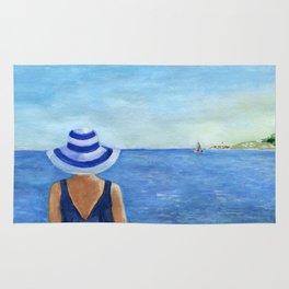 Girl at the sea Rug
