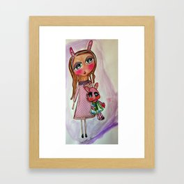 the girl with the estrange pink rabbit Framed Art Print