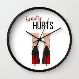 Beauty hurts Wall Clock