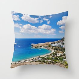 The village of Lindos with a beautiful bay, medieval castle and pictursque houses in Rhodes, Greece. Throw Pillow