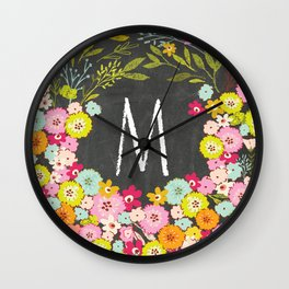 M botanical monogram. Letter initial with colorful flowers on a chalkboard background Wall Clock