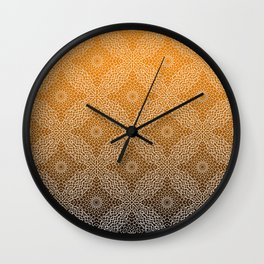 Detailed, lace like mandala pattern in white with gradient black and orange background Wall Clock