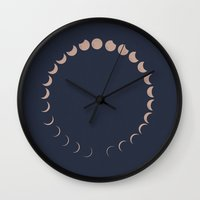 moon phases Wall Clocks featuring moon phases by Emma S