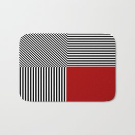 Geometric abstraction: black and white stripes, red square Bath Mat