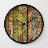 world maps Wall Clocks featuring Around the World in Thirteen Maps by Diego Tirigall