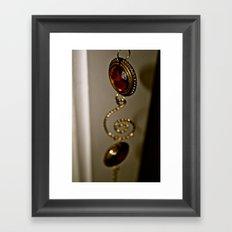 Hanging amber Framed Art Print