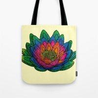 lotus flower Tote Bags featuring Lotus  by Luna Portnoi