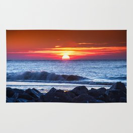 Sunset and a wave Rug