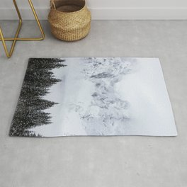 Snowy mountains and spruce forest Rug