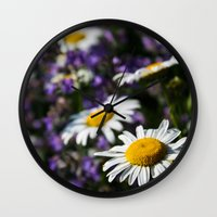 rileigh smirl Wall Clocks featuring Field of Daisies by Rileigh Smirl