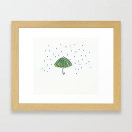 Rain drops and umbrella Framed Art Print