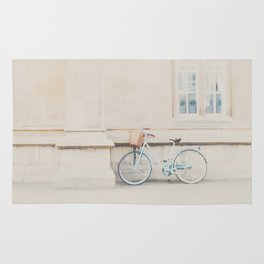 a mint green bicycle is the perfect way to travel around Cambridge Rug