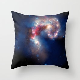 1869. A Galactic Spectacle: A pair of colliding galaxies about 62 million light years from Earth. Throw Pillow