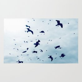 Free - Seagulls fly high up in the sky. Rug
