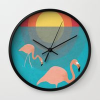 flamingos Wall Clocks featuring Flamingos by Simon Alenius