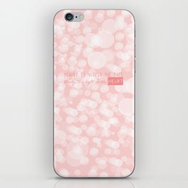 Beauty is not in the face; beauty is a light in the heart. iPhone Skin