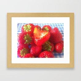 bitten strawberry  Framed Art Print