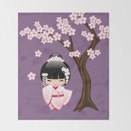 Japanese Bride Kokeshi Doll on Purple Throw Blanket