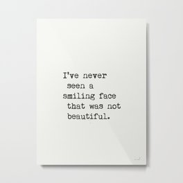 I've never seen a smiling face that was not beautiful. Metal Print