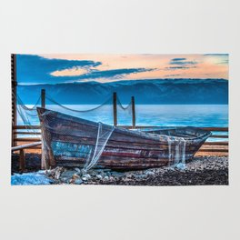 Old fishing boat with net Rug