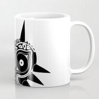 majoras mask Mugs featuring Majoras Mask by Tom Milburn