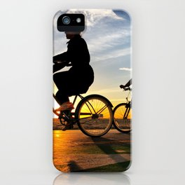 Cycling on sunset in Santa Monica, California, USA iPhone Case