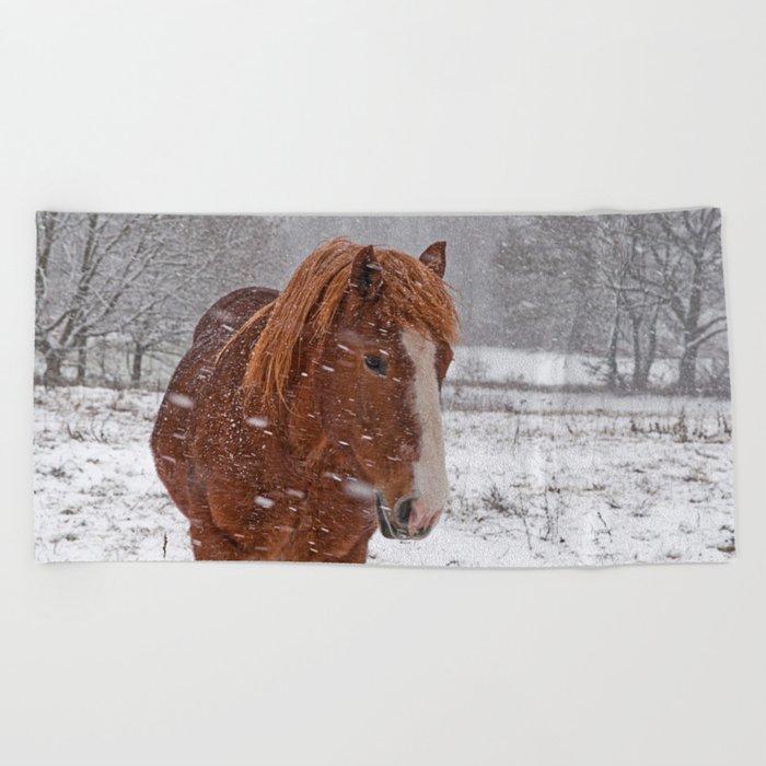 Horse in the snow Beach Towel
