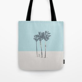 Palm trees on a solitary beach Tote Bag