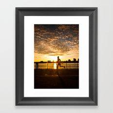Sunset runner Framed Art Print