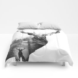 Deer in the woods Comforters