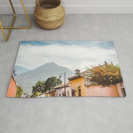 Colorful houses of a street in Antigua Guatemala with volcano views Rug