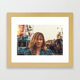 Lovely young woman in a Luna Park shortly before sunset in autumn Framed Art Print