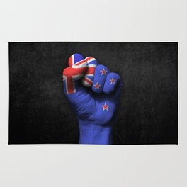 New Zealand Flag on a Raised Clenched Fist Rug