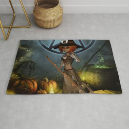 Cute little witch with pumpkin in the night Rug