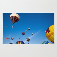 hot air balloons Area & Throw Rugs featuring Vibrant Hot Air Balloons by Nicolas Raymond