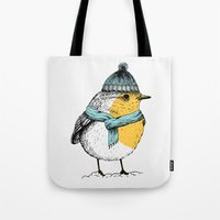 Tote Bags featuring Winter bird by Tariana B.