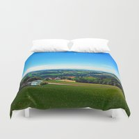 airplanes Duvet Covers featuring Condensation trail with some scenery by Patrick Jobst