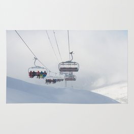 Skiers on chairlift, Alps Rug