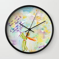 le petit prince Wall Clocks featuring Le Petit Prince- The little Prince flying by Colorful Simone