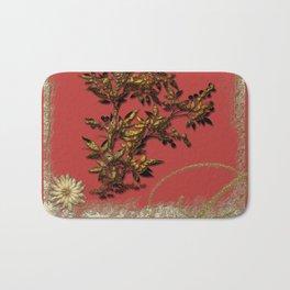 Golden flower on red Bath Mat