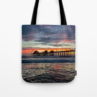 calendars Tote Bags featuring Huntington Beach Sunset  1/26/14 by John Minar Fine Art Photography