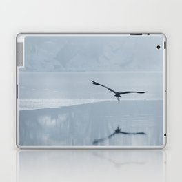 Gray heron flying over a frozen lake, Winter frozen lake. Laptop & iPad Skin