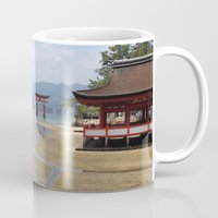 greg guillemin Mugs featuring Itsukushima Shrine - Greg Katz by Artlala for MSF Doctors Without Borders
