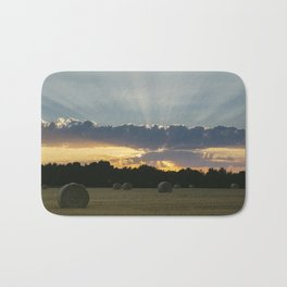 Field of round straw bales at sunset. Norfolk, UK. Bath Mat